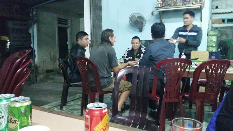 Ho Chi Minh trail, eating and drining with policemen