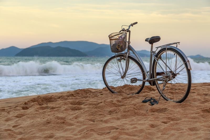 bicycle sitting on the nha trang beach.jpg