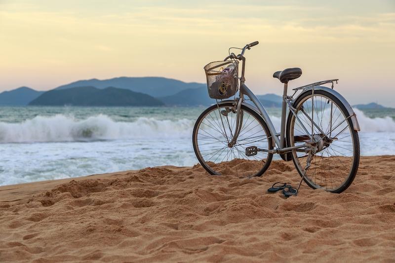 bicycle sitting on the nha trang beach.jpg