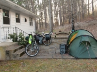 camp_behind_forest_house