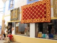 women_stitching_carpet